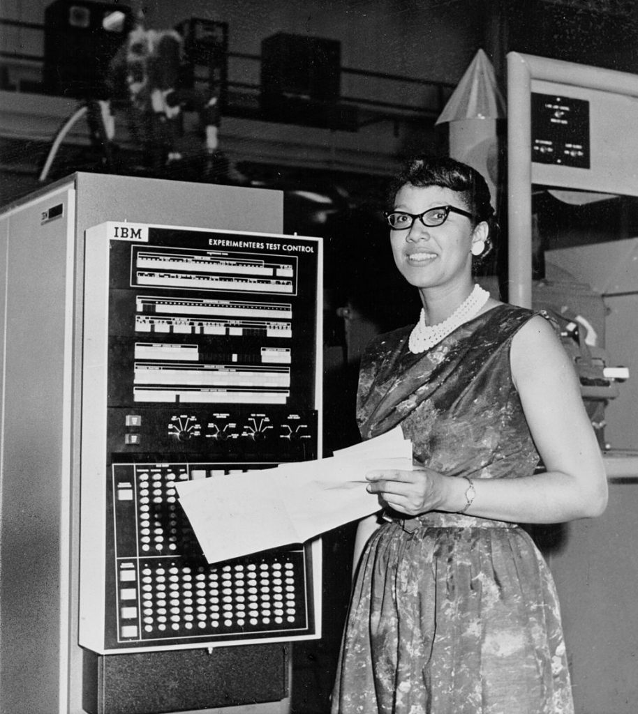 "Melba Roy heads the group of NASA mathematicians, known as ""computers,"" who track the Echo satellites. Roy's computations help produce the orbital element timetables by which millions can view the satellite from Earth as it passes overhead. She went on to become Program Production Section Chief at Goddard Space Flight Center."